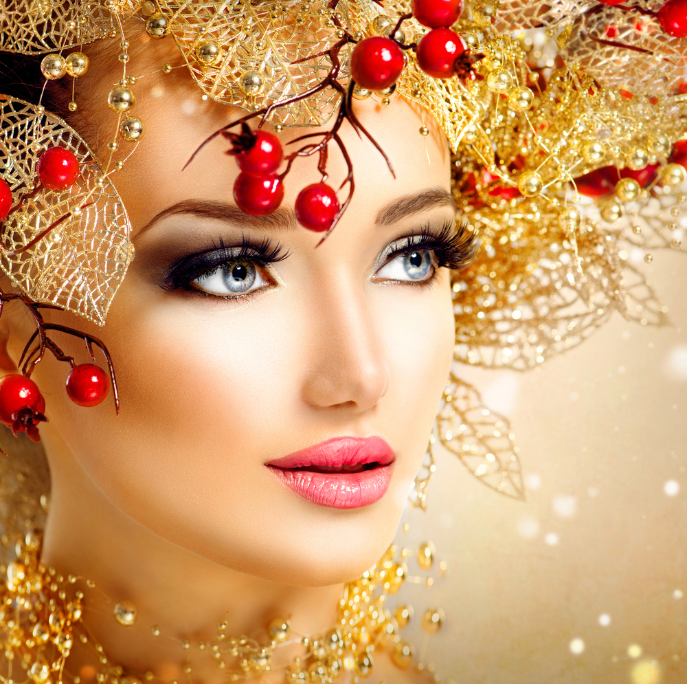 Christmas fashion model girl with golden hairstyle and makeup