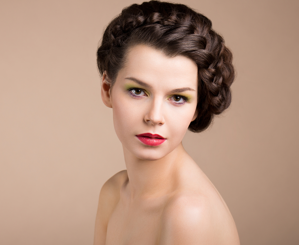 Femininity. Nostalgia. Retro Styled Pinup Girl with Brown Braided Hair. Romance