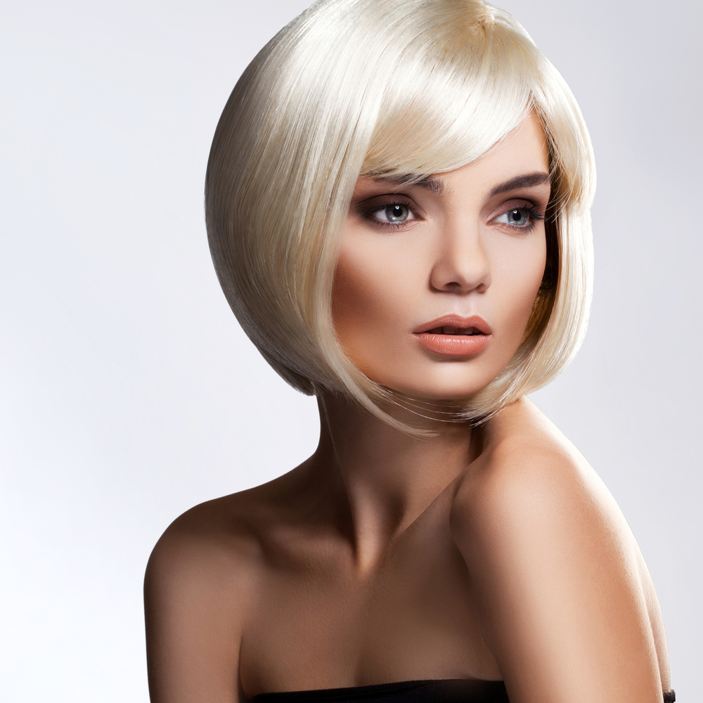 Blonde Hair. Portrait of beautiful blonde with with Short Hair. High quality image.