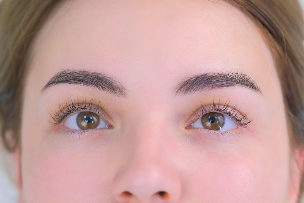 Woman's lashes after beauty procedure of eyelash lifting and laminating, closeup